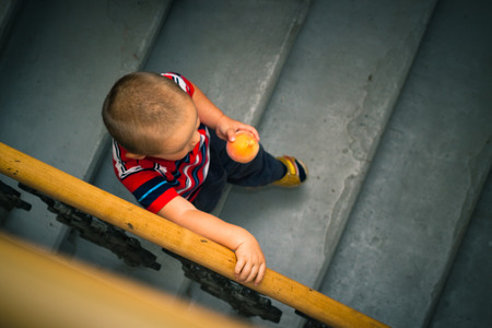 little boy on the stairs. photo