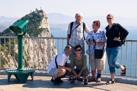 Portrait of happy tourist people on the Rock of Gibraltar. photo
