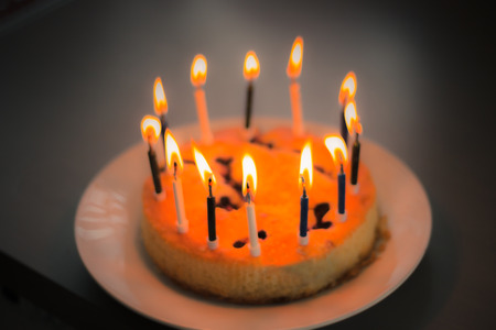 Birthday cake with candles on dark background photo