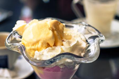 Sundae with whipped cream, vanilla and strawberry ice cream  photo