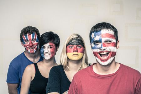 supporter: Group of funny people with painted flags on their faces.