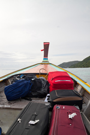 long tailed boat: Detail of long tailed boat full of luggage head for Phi Phi Island  Thailand.
