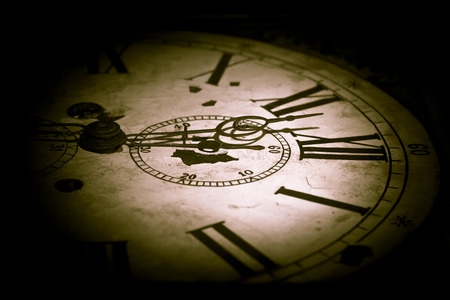 Abstract creative photo of dark clock face.