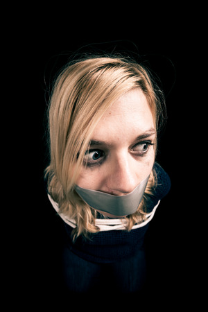 torture: Kidnapped woman hostage with tape over mouth and tied up with rope