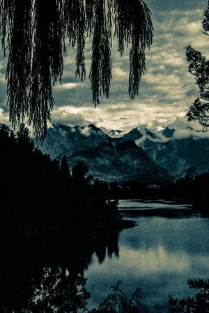 Beautiful dark landscape at Mount Cook, Southern Alps, New Zealand. Toned grainy 35mm film scan. photo