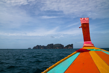 phi phi: Detail of long tail boat and beautiful scenic coastline of Phi Phi Island in Thailand.
