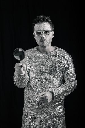 weirdo: Funny spaceman holding magnifying glass. Stock Photo