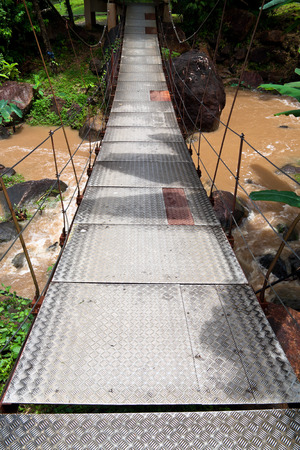 waterfall  dirty: Suspension bridge in tropical forest. Langkawi, Malaysia.