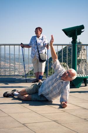 hilarious: Happy hilarious senior man tourist on the top of Gibraltar Rock.