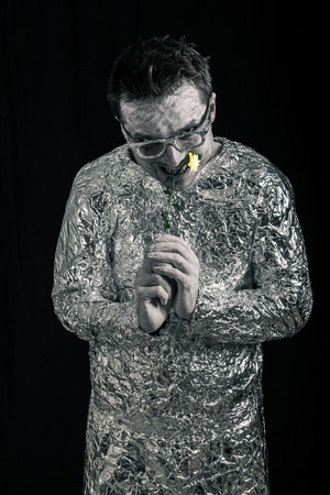 spaceman: Funny spaceman eating flower. Stock Photo