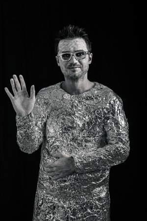 Portrait of spaceman greeting. photo