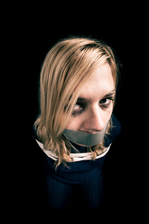 kidnapped: Kidnapped woman hostage with tape over mouth and tied up with rope