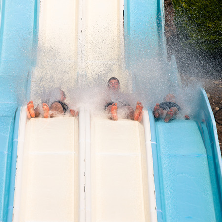 People water slide at aqua park. photo