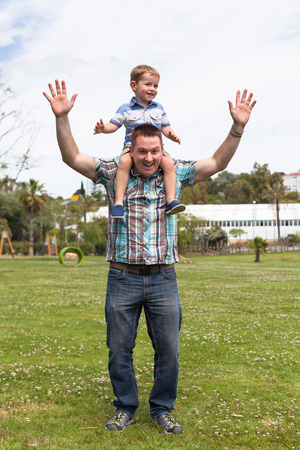 leeway: Happy daddy and his son having fun in the park outdoors. Happiness, fatherhood and childhood concept. Stock Photo