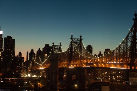 queensboro bridge: The Ed Koch Queensboro Bridge a cantilever bridge over the East River at twilight in New York City, USA.