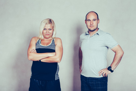 bald girl: Portrait of confident sporty corpulent couple.