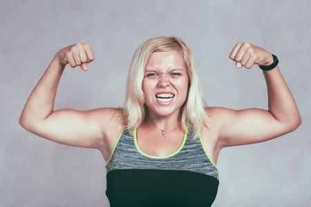 Muscle Woman Flexing Biceps