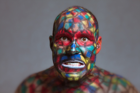 Furious villain portrait, colorful face art with tilt shift and motion blur effect. photo