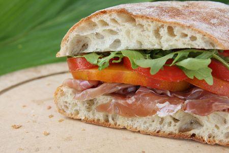 Prosciutto, tomato and arugula sandwich on a ciabatta.