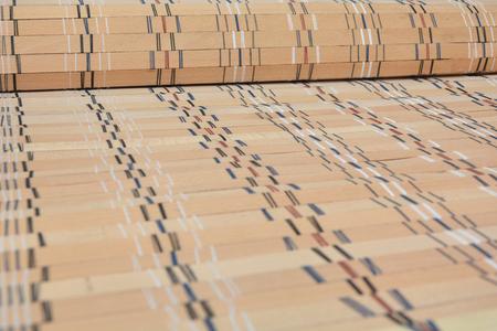 Sun blocked by wooden venetian blinds