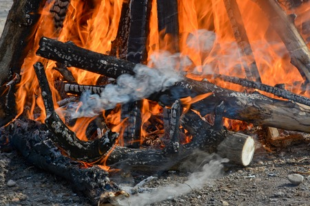 Slavic holiday end of winter. A large terry doll of straw is burning. Black smoke is visible