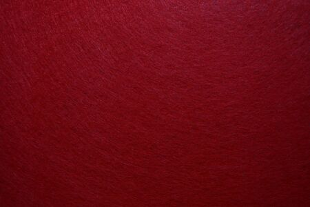 Abstract background with red texture, velvet fabric, full frame, close-up Stockfoto
