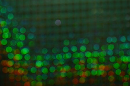 Abstract warm bokeh effect on blue background. Gold glitter lights. Stockfoto