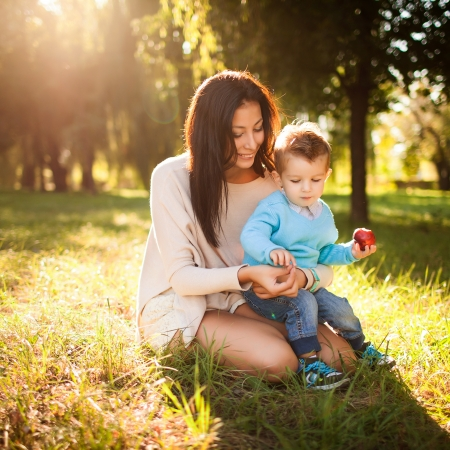 kid's day: baby boy with his mum in the park