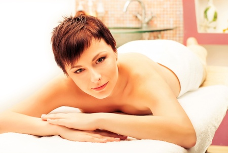 beautiful smiling woman laying on spa procedures Stock Photo - 17749143