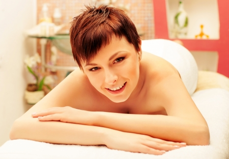 beautiful smiling woman laying on spa procedures