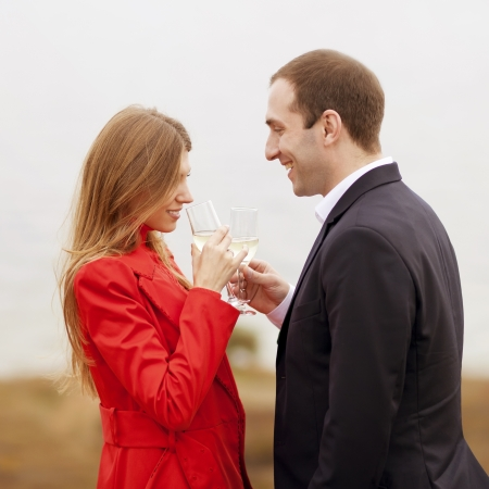 young couple drinking champagne in the sea Stock Photo