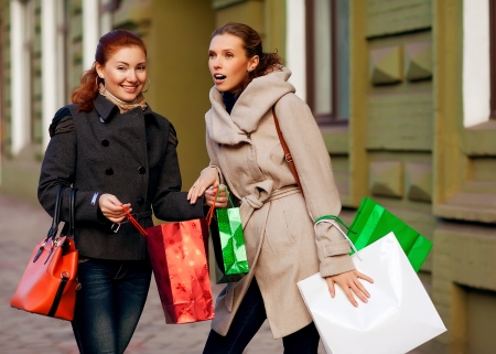 go shopping: Two young attractive girlfriends go shopping