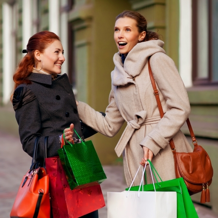 Two young attractive girlfriends go shopping