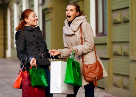 Happy girls out shopping Stock Photo - 18576092