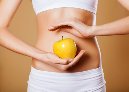 beautiful female body and apple Stock Photo - 17882509