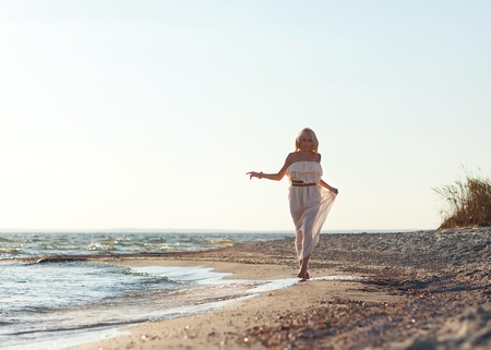 girl walking along the beach. Stock Photo - 18571649