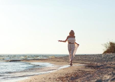 girl walking along the beach. Stock Photo - 18571649
