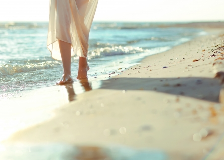 A girl walking on a beach in sea