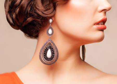closeup body part portrait of young beautiful woman in jewellery photo