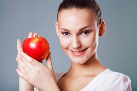 Head shot of woman holding apple Stock Photo - 18562483