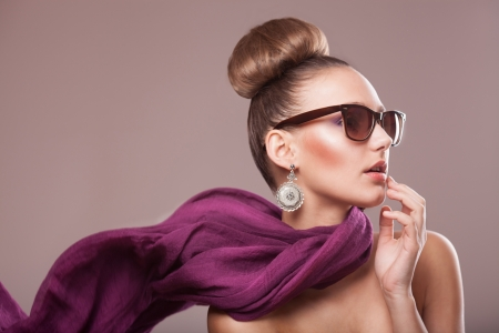 fashion girl with a purple scarf, wearing sunglasses, updo Stock Photo