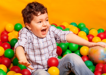 Cute kid or child playing colorful balls top view photo