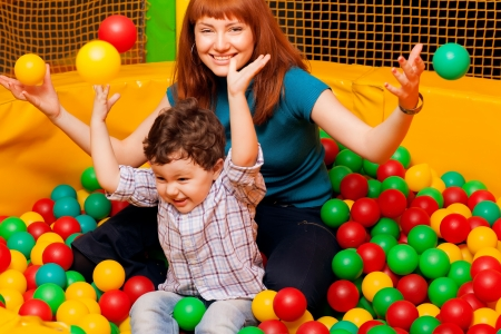child playing colorful balls with Mom photo