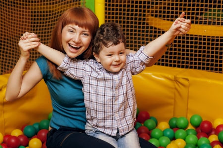 child playing colorful balls with Mom Stock Photo