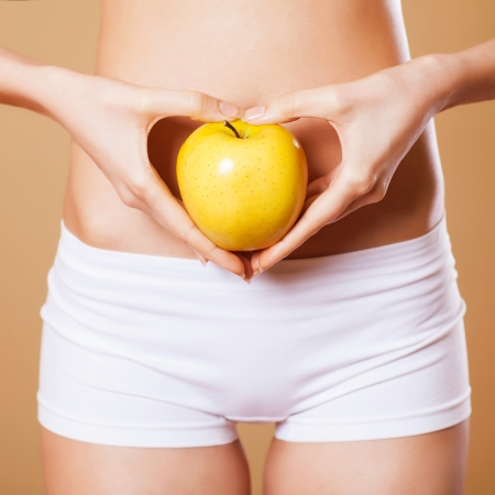 beautiful female body and apple Stock Photo - 18577291