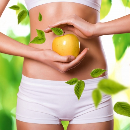 beautiful female body and apple Stock Photo