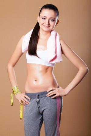 sports wear: Young happy woman in sports wear, studio shot