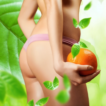 with orange and white body: Hip, legs, abdomen and orange in hand cellulite liposuction woman weight loss control concept, close up