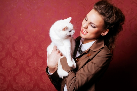 girl holding a cat in studio photo