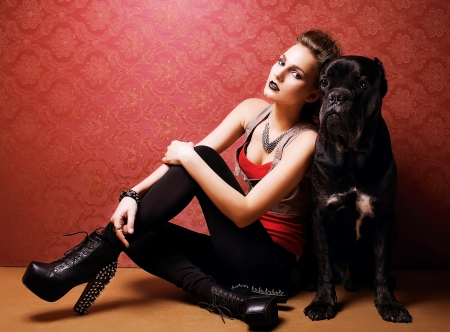 cane corso: Pretty young woman smiling while embracing her cane corso